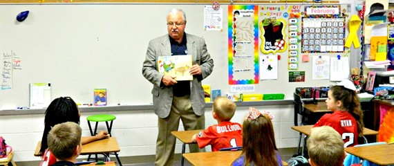 "Sheriff Larry Dean reading to one of our 3rd grade classes on ""Read Across America Day"" at SWLE!"