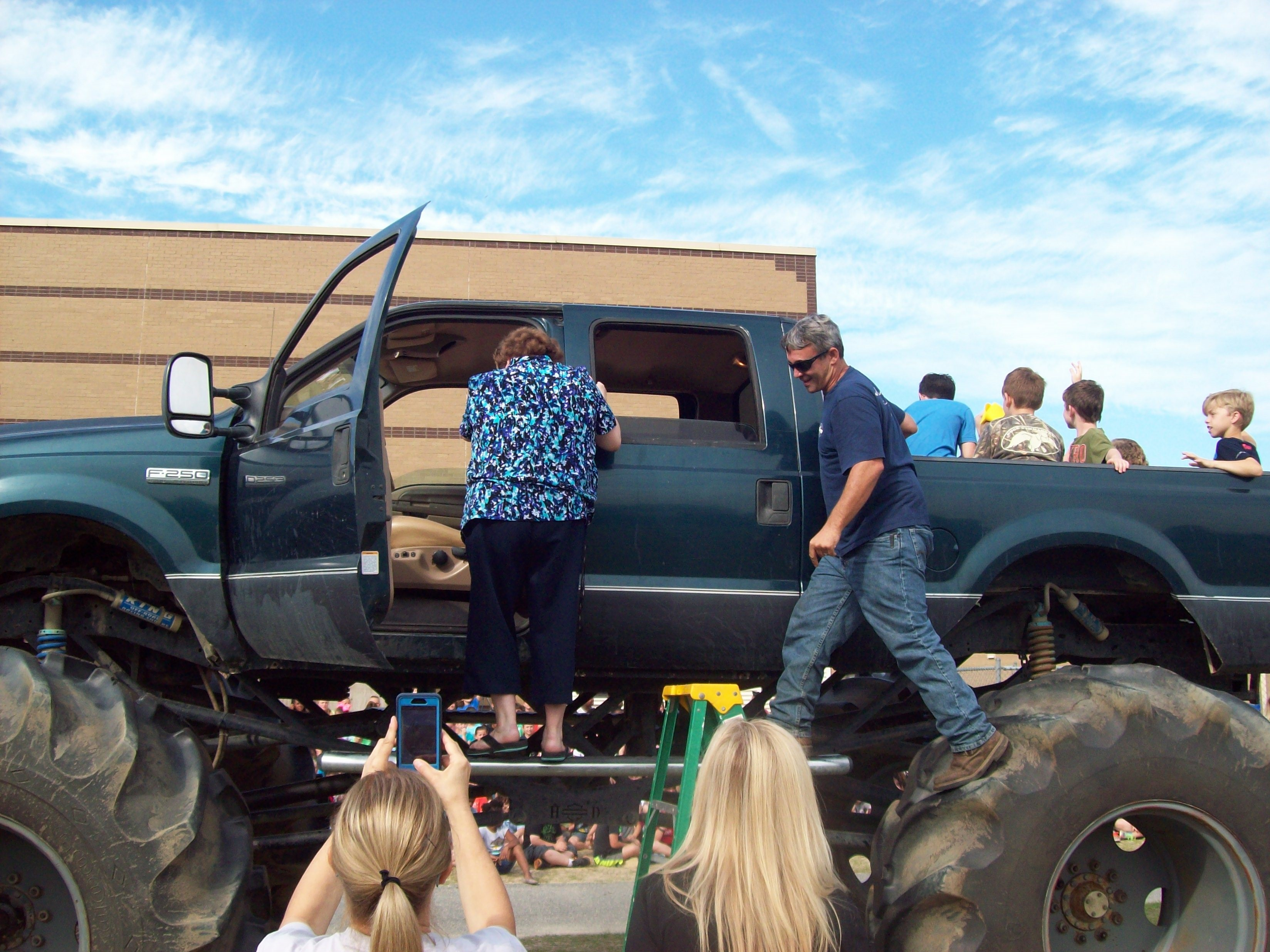 It's a long way up! .... Dr. Tippett getting in the Monster truck at our EOY AR Celebration!
